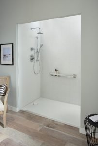 White walk-in shower with silver fixtures
