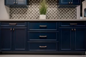 Dark blue cabinets with simple gold hardware